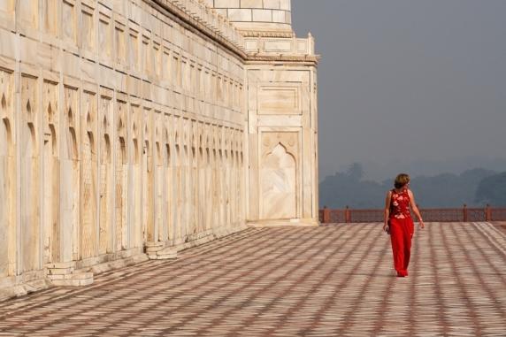 Tourist in red at Taj Mahal