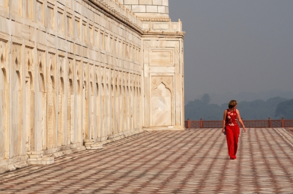 Tourist in red at Taj Mahal