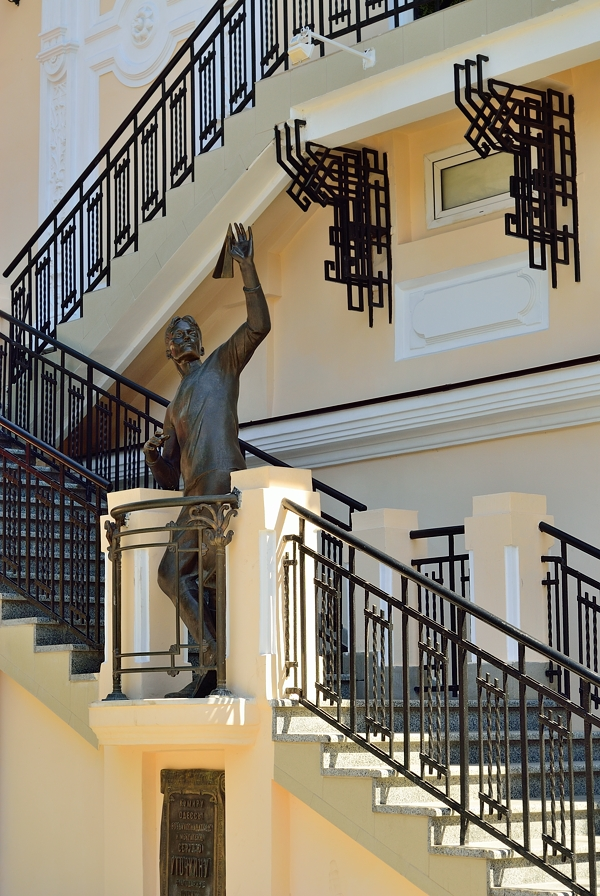 Wrought iron railing with statue