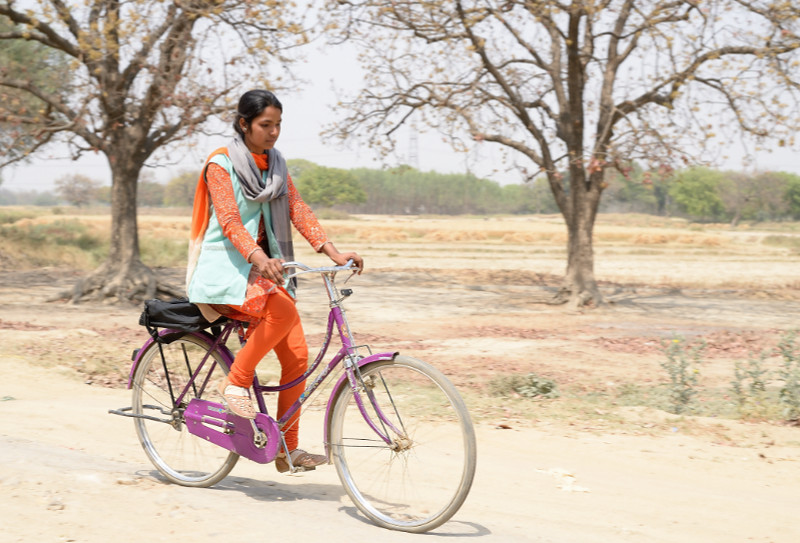Community health worker on bicycle