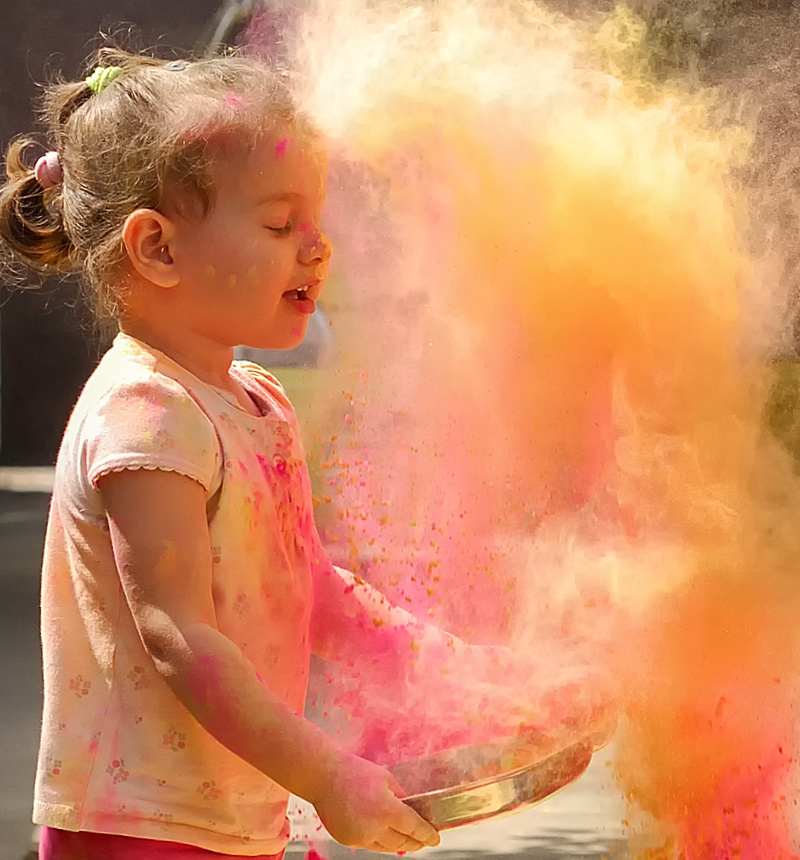 Kid playing with Holi Colors