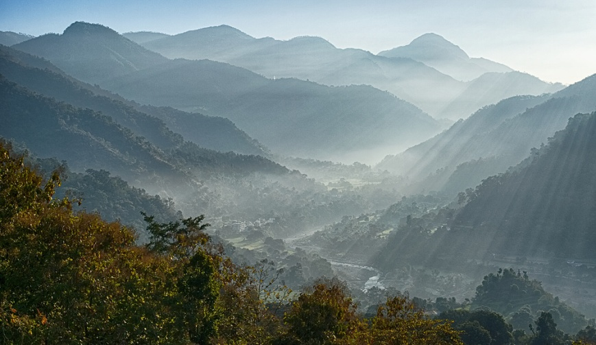 Sunrays over valley